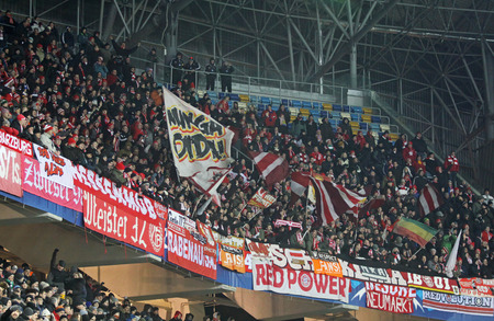 ultras: LVIV, UKRAINE - FEBRUARY 17, 2015: FC Bayern Munich team supporters show their support during UEFA Champions League game against Shakhtar Donetsk at Arena Lviv Editorial