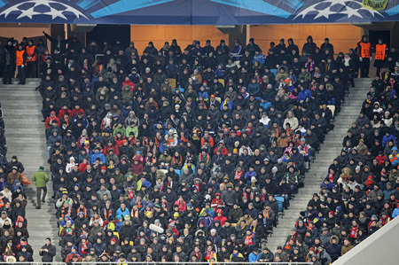 LVIV, UKRAINE - FEBRUARY 17, 2015: Tribunes of Arena Lviv stadium during UEFA Champions League game between Shakhtar Donetsk and FC Bayern Munich