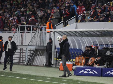 josep: LVIV, UKRAINE - FEBRUARY 17, 2015: FC Bayern Munich manager Josep Guardiola looks on during UEFA Champions League game against Shakhtar Donetsk at Arena Lviv stadium Editorial