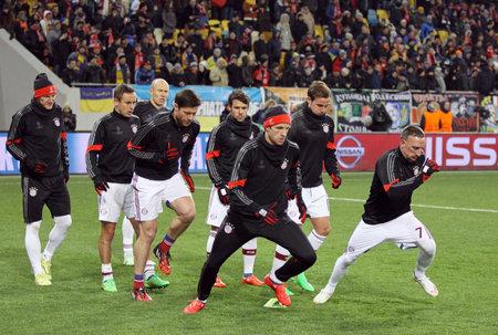 warm up: LVIV, UKRAINE - FEBRUARY 17, 2015: FC Bayern Munich players warm up before UEFA Champions League game against FC Shakhtar Donetsk at Arena Lviv stadium Editorial