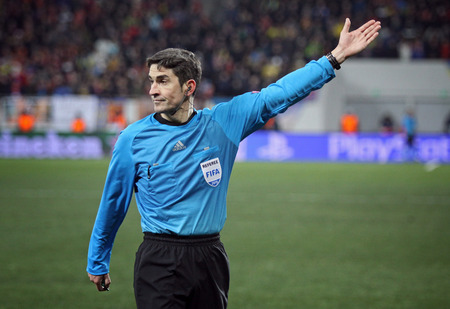 champion of spain: LVIV, UKRAINE - FEBRUARY 17, 2015: Referee Alberto Undiano Mallenco of Spain in action during UEFA Champion League game between Shakhtar Donetsk and FC Bayern Munich at Arena Lviv stadium