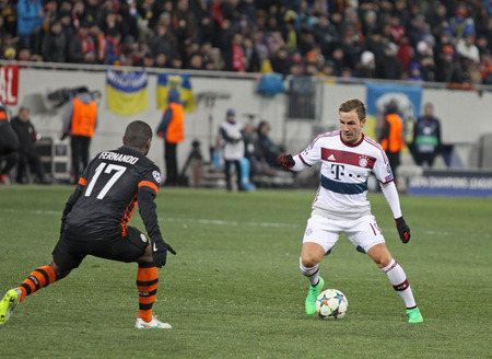 mario: LVIV, UKRAINE - FEBRUARY 17, 2015: Mario Gotze of Bayern Munich (R) fights for a ball with Fernando of Shakhtar Donetsk during their UEFA Champions League game at Arena Lviv stadium Editorial