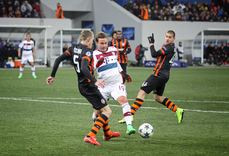 mario: LVIV, UKRAINE - FEBRUARY 17, 2015: Mario Gotze of Bayern Munich (in White) fights for a ball with Shakhtar Donetsk players during their UEFA Champions League game at Arena Lviv stadium Editorial