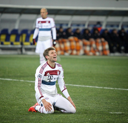 reacts: LVIV, UKRAINE - FEBRUARY 17, 2015: Thomas Muller of Bayern Munich reacts after missed a goal during UEFA Champions League game against FC Shakhtar Donetsk