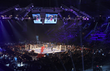 ring light: KYIV, UKRAINE - DECEMBER 13, 2014: Tribunes of Palace of Sports in Kyiv during Evening of Boxing