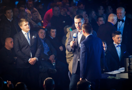 the heavyweight: KYIV, UKRAINE - DECEMBER 13, 2014: Mayor of Kyiv city and former WBC and WBO heavyweight champion Vitali Klitschko (in center) during Evening of Boxing Editorial