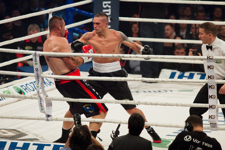 intercontinental: KYIV, UKRAINE - DECEMBER 13, 2014: Oleksandr Usyk of Ukraine (white-black shorts) and Danie Venter of South Africa in the ring during WBO Intercontinental Cruiserweight Title fight Editorial