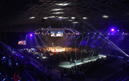 olympic ring: KYIV, UKRAINE - DECEMBER 13, 2014: Tribunes of Palace of Sports in Kyiv during Evening of Boxing