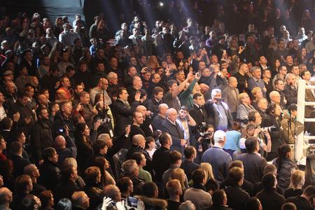 intercontinental: KYIV, UKRAINE - DECEMBER 13, 2014: People sing the National Anthem of Ukraine before WBO Intercontinental Cruiserweight Title fight between Oleksandr Usyk (Ukraine) and Danie Venter (South Africa)