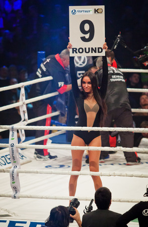 boxing sport: KYIV, UKRAINE - DECEMBER 13, 2014: Boxing ring girl holding a board with round number during WBO Intercontinental cruiserweight Title fight Oleksandr Usyk vs Danie Venter