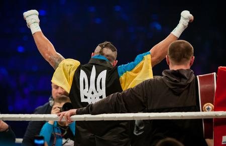 intercontinental: KYIV, UKRAINE - DECEMBER 13, 2014: Oleksandr Usyk of Ukraine reacts after winning the WBO Intercontinental cruiserweight Title in the fight with Danie Venter