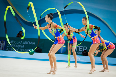 hoops: KYIV, UKRAINE - SEPTEMBER 1, 2013: Team of China performs during 32nd Rhythmic Gymnastics World Championship (Group Apparatus Final competition) at Palace of Sports in Kyiv