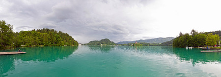 julian: Wide panoramic view of Bled Lake in spring, Julian Alps, Slovenia Stock Photo