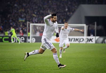 reacts: KYIV, UKRAINE - MARCH 19, 2015: Miguel Veloso of FC Dynamo Kyiv reacts after scores a goal during UEFA Europa League game against FC Everton at Olympic stadium in Kyiv Editorial