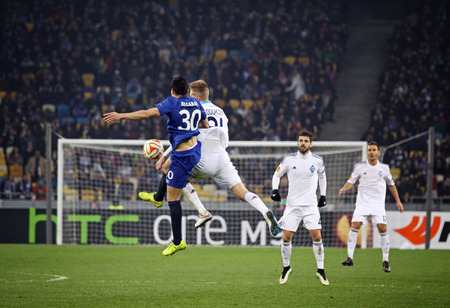 KYIV, UKRAINE - MARCH 19, 2015: Antolin Alcaraz of FC Everton (L) fights for a ball with Lukasz Teodorczyk of FC Dynamo Kyiv during their UEFA Europa League game at Olympic stadium in Kyiv