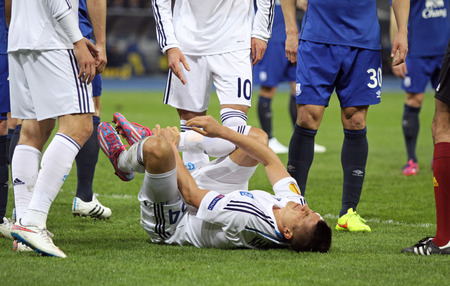 reacts: KYIV, UKRAINE - MARCH 19, 2015: Yevhen Khacheridi of Dynamo Kyiv reacts after injured during UEFA Europa League game against FC Everton at Olympic stadium in Kyiv