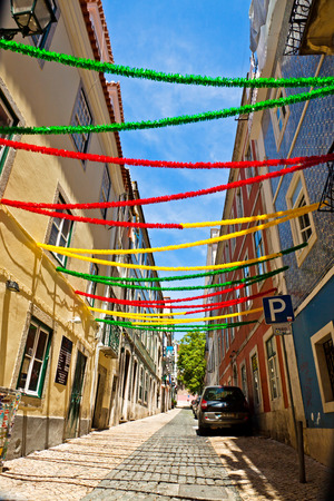 LISBON PORTUGAL  JUNE 13 2013: Lisbon street with holiday decoration during Lisbon Festival Festas de Lisboa