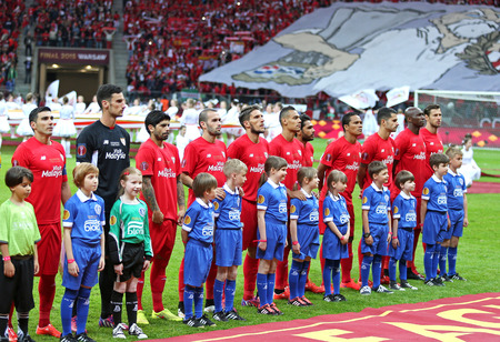 bacca: WARSAW, POLAND - MAY 27, 2015: FC Sevilla players listen to UEFA anthem before UEFA Europa League Final game against FC Dnipro at Warsaw National Stadium