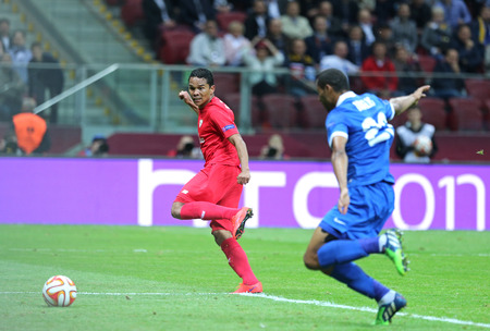 carlos: WARSAW, POLAND - MAY 27, 2015: Carlos Bacca in Red of FC Sevilla scores a goal during UEFA Europa League Final game against FC Dnipro at Warsaw National Stadium