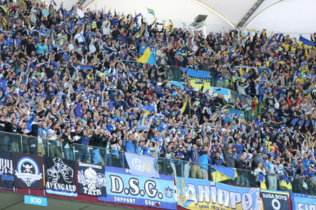 ultras: WARSAW, POLAND - MAY 27, 2015: FC Dnipro team ultra supporters ultras show their support during UEFA Europa League Final game against Sevilla at Warsaw National Stadium