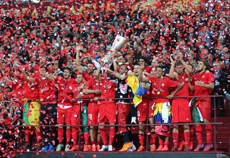 bacca: WARSAW, POLAND - MAY 27, 2015: FC Sevilla players celebrate their winning of the UEFA Europa League 2015 after the game against Dnipro at Warsaw National Stadium