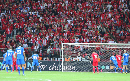 football stadium: WARSAW, POLAND - MAY 27, 2015: FC Dnipro players score a goal during UEFA Europa League Final game against FC Sevilla at Warsaw National Stadium