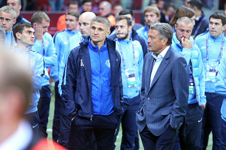 react: WARSAW, POLAND - MAY 27, 2015: FC Dnipro players and staff react after lose the Final game of UEFA Europa League against FC Sevilla at Warsaw National Stadium