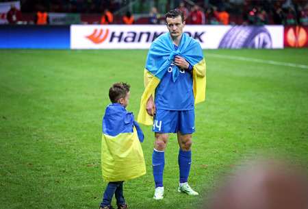 react: WARSAW, POLAND - MAY 27, 2015: Artem Fedetskiy and his son react after FC Dnipro loses the Final game of UEFA Europa League against FC Sevilla at Warsaw National Stadium Editorial