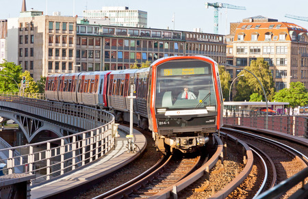 db: HAMBURG, GERMANY - JULY 25, 2014: Train arrives at Baumwall U-Bahn Station in Hamburg. Hamburg U-Bahn Metro Rapid Transit System was opened in 1912 and comprises four lines serving 91 stations Editorial