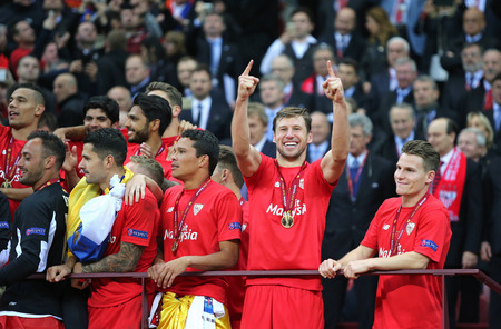 carlos: WARSAW, POLAND - MAY 27, 2015: FC Sevilla players celebrate after winning UEFA Europa League Trophy in the game against FC Dnipro at Warsaw National Stadium