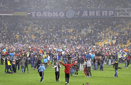 run out: KYIV, UKRAINE - MAY 14, 2015: FC Dnipro supporters run out into the pitch to celebrate victory after UEFA Europa League semifinal game against Napoli at NSK Olimpiyskyi stadium
