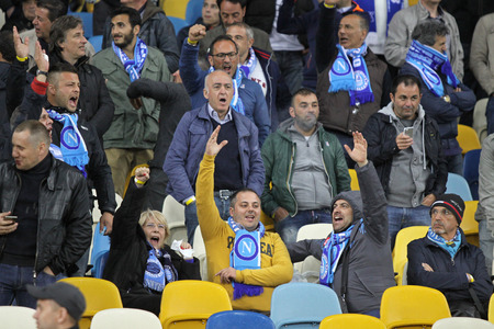 ultras: KYIV, UKRAINE - MAY 14, 2015: SSC Napoli supporters show their support during UEFA Europa League semifinal game against Dnipro at NSK Olimpiyskyi stadium in Kyiv Editorial