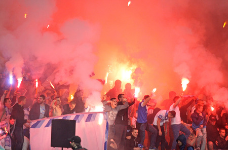 dnipro: KYIV, UKRAINE - MAY 14, 2015: FC Dnipro ultras ultra supporters burn flares during UEFA Europa League semifinal game against Napoli at NSK Olimpiyskyi stadium in Kyiv