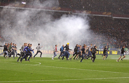 ultras: KYIV, UKRAINE - MAY 14, 2015: FC Dnipro supporters run out into the pitch to celebrate victory after UEFA Europa League semifinal game against Napoli at NSK Olimpiyskyi stadium