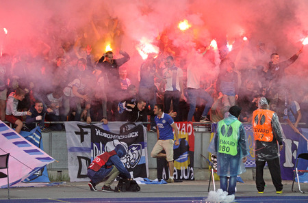 ultras: KYIV, UKRAINE - MAY 14, 2015: FC Dnipro ultras ultra supporters burn flares during UEFA Europa League semifinal game against Napoli at NSK Olimpiyskyi stadium in Kyiv