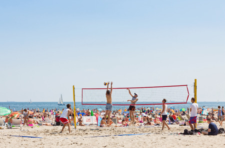 baltic people: GDYNIA, POLAND - AUGUST 2, 2015: People play volleyball on Municipal beach in Gdynia city, Baltic sea, Poland Editorial