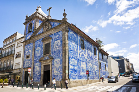 PORTO, PORTUGAL - JUNE 19, 2013: Capela das Almas Capela de Santa Catarina. Located on the pedestrian Santa Catarina Street and decorated with the typical Portuguese Tiles Azulejos by painter Eduardo Leite