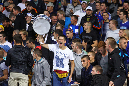 react: KYIV, UKRAINE - SEPTEMBER 16, 2015: FC Dynamo Kyiv ultra supporters react after Dynamo scored a goal during UEFA Champions League game against FC Porto Editorial