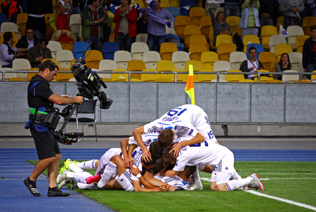 react: KYIV, UKRAINE - SEPTEMBER 16, 2015: FC Dynamo Kyiv players react after score a goal during UEFA Champions League game against FC Porto at NSC Olimpiyskyi stadium Editorial