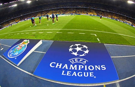 olimpiysky: KYIV, UKRAINE - SEPTEMBER 16, 2015: Board with UEFA Champions League Logo on the grass before the game between FC Dynamo Kyiv and FC Porto at NSC Olimpiyskyi stadium Editorial