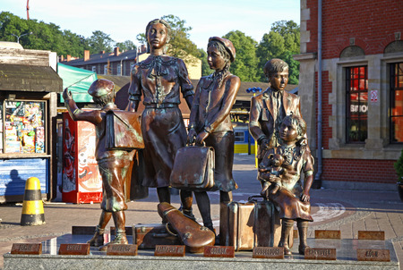 deported: GDANSK, POLAND - JULY 25, 2012: Kindertransport Monument near Gdansk Railway station, Poland. Monument commemorates the transports of Jewish children to the UK during WW2. Designed by sculptor Frank Meisler who was himself one of the children of the Kinde Editorial