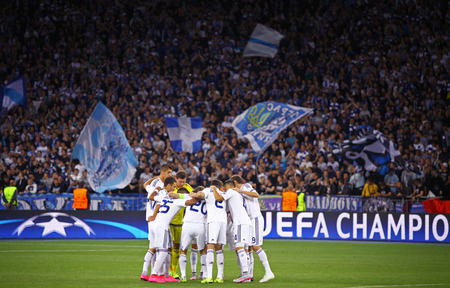 chear: KYIV, UKRAINE - SEPTEMBER 16, 2015: FC Dynamo Kyiv players cheer each other up during UEFA Champions League game against FC Porto at NSC Olimpiyskyi stadium Editorial