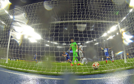 kick: KYIV, UKRAINE - MAY 14, 2015: Yevhen Seleznyov of FC Dnipro 2nd from left, in Blue scores against SSC Napoli during their UEFA Europa League semifinal game at NSK Olimpiyskyi stadium in Kyiv Editorial