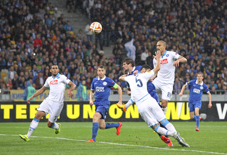 scores: KYIV, UKRAINE - MAY 14, 2015: Yevhen Seleznyov of FC Dnipro 4th from left, in Blue scores against SSC Napoli during their UEFA Europa League semifinal game at NSK Olimpiyskyi stadium in Kyiv