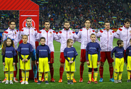 KYIV, UKRAINE - OCTOBER 12, 2015: Players of National football team of Spain sing National anthem before UEFA EURO 2016 Qualifying game against Ukraine at NSK Olimpiyskyi stadium in Kyiv