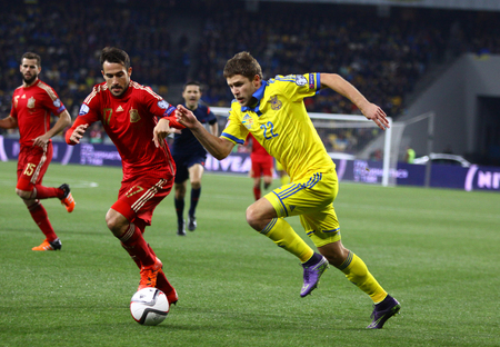 gaspar: KYIV, UKRAINE - OCTOBER 12, 2015: Artem Kravets of Ukraine R fights for a ball with Mario Gaspar of Spain during their UEFA EURO 2016 Qualifying game at NSK Olimpiyskyi stadium in Kyiv