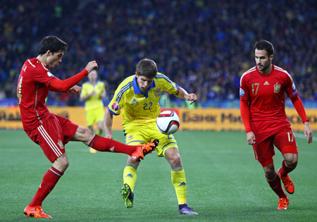 gaspar: KYIV, UKRAINE - OCTOBER 12, 2015: Artem Kravets of Ukraine C fights for a ball with Xabier Etxeita L and Mario Gaspar R of Spain during their UEFA EURO 2016 Qualifying game