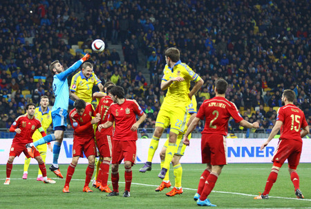 KYIV, UKRAINE - OCTOBER 12, 2015: Ukrainian yellow and Spain footballers fight for a ball during their UEFA EURO 2016 Qualifying game at NSK Olimpiyskyi stadium in Kyiv