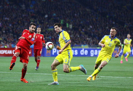 gaspar: KYIV, UKRAINE - OCTOBER 12, 2015: Taras Stepanenko of Ukraine in center fights for a ball with Mario Gaspar of Spain during their UEFA EURO 2016 Qualifying game at NSK Olimpiyskyi stadium in Kyiv