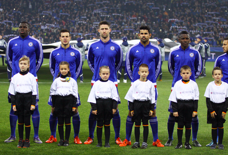 KYIV, UKRAINE - OCTOBER 20, 2015: FC Chelsea players listen official anthem before UEFA Champions League game against FC Dynamo Kyiv at NSC Olimpiyskyi stadium in Kyiv